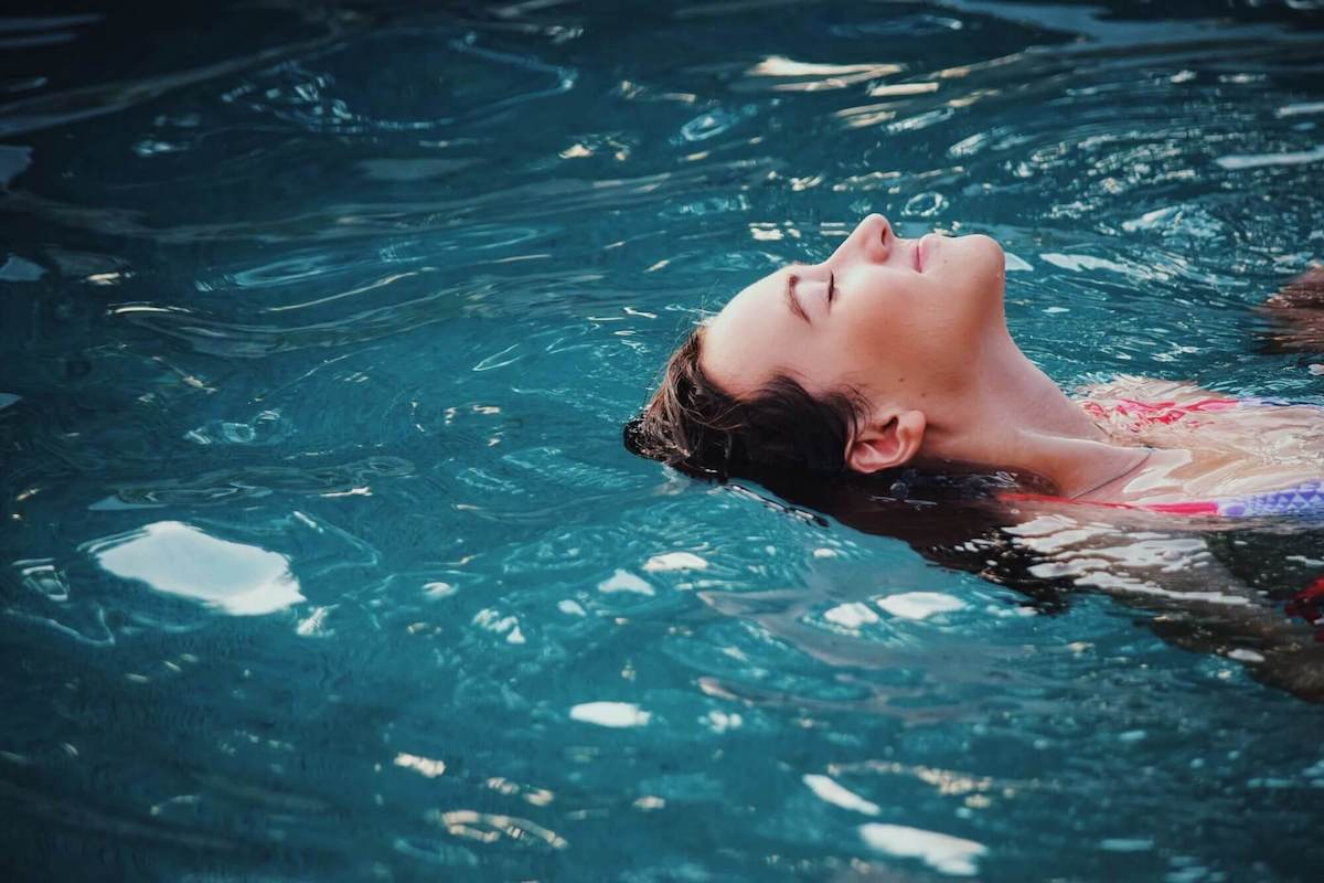 A woman relaxing during float therapy